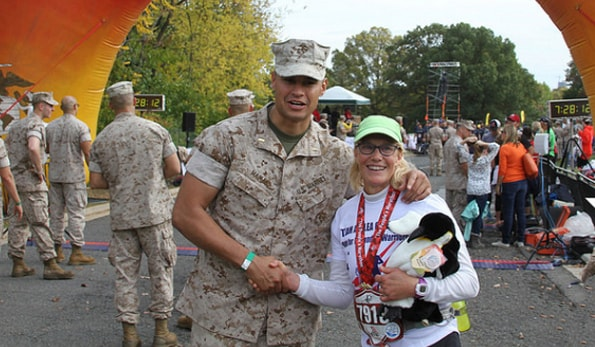 marine_and_marathon_runner_shaking_hands