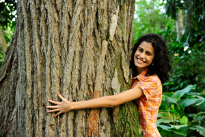lady with her arms around a large tree