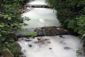 White cloudy or milky stream water.