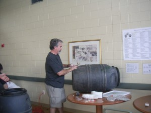 Man assembling his rain barrel at one of the regional workshops.