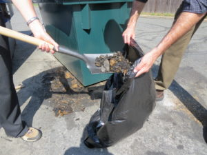 Using dry cleanup methods, such as shoveling grease and dirt, ensure that you do not wash the pollutants down a storm drain.