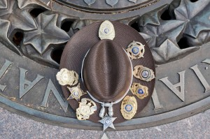 An ACSO sheriff's deputy uniform hat on the memorial