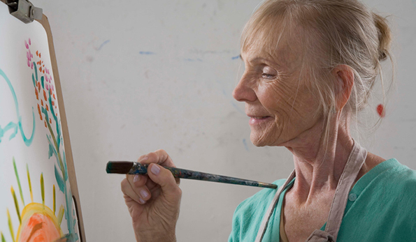 an older woman painting