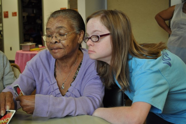 Teen helping senior