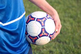 teen holding soccer ball