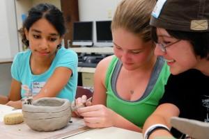 Teens building ceramics.