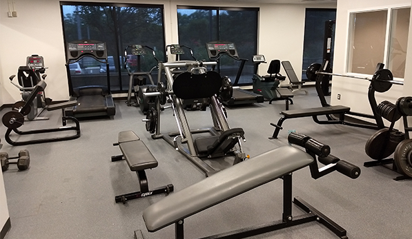 image of weight room with fitness equipment and windows
