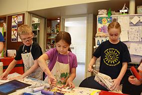 kids painting during winter break camp