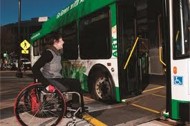 Older woman in wheelchair boarding ART bus