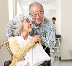 Older Asian couple in long-term care setting