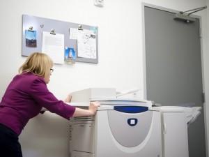 Pushing heavy copier to block doorway from a gunman