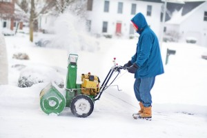 Person using snow blower