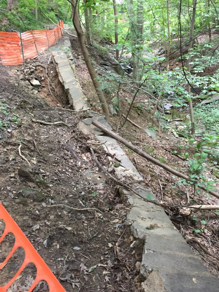 Erosion has undermined the wall along the trail and it has collapsed