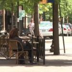 Pedestrians on a summer day in Clarendon