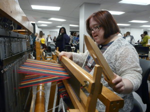 Working on a weaving project in the new Arlington Weaves, Etc. space.