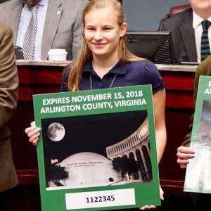 girl holds winning design