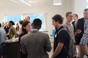 community members speak at the May 31 Happy Hour event