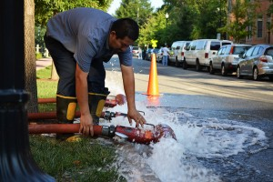 Arlington County crew flushing a fire hydrant.