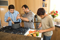 father_sons_cooking_kitchen