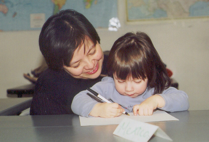 mother_teaching_child_writing