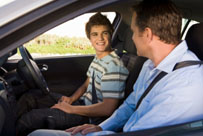 son_in_car_with_dad