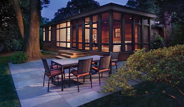 modern cedar living space addition including view of backyard landscaping
