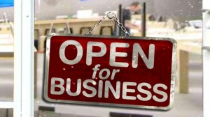 "Photo of store sign that reads, ""Open for business"""