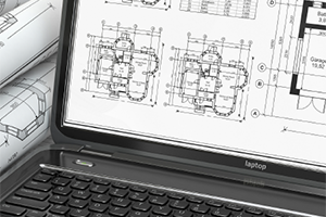 laptop with building plans displayed
