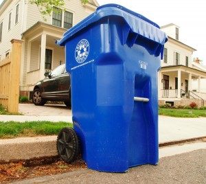 Arlington blue recycling cart on curb.